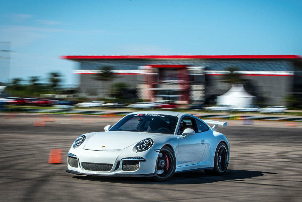 driving a porsche gt3 on a race track in new orleans